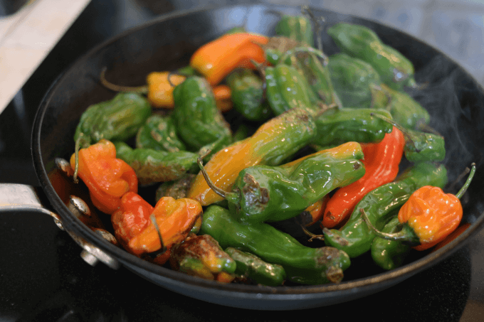 Toss the peppers occasionally until they blister on one side.  About  10 minutes.
