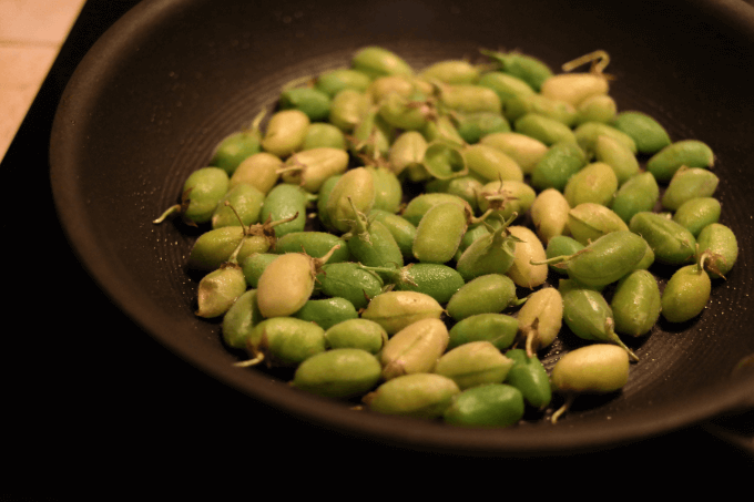 Saute in olive oil until some of the pods are charred.